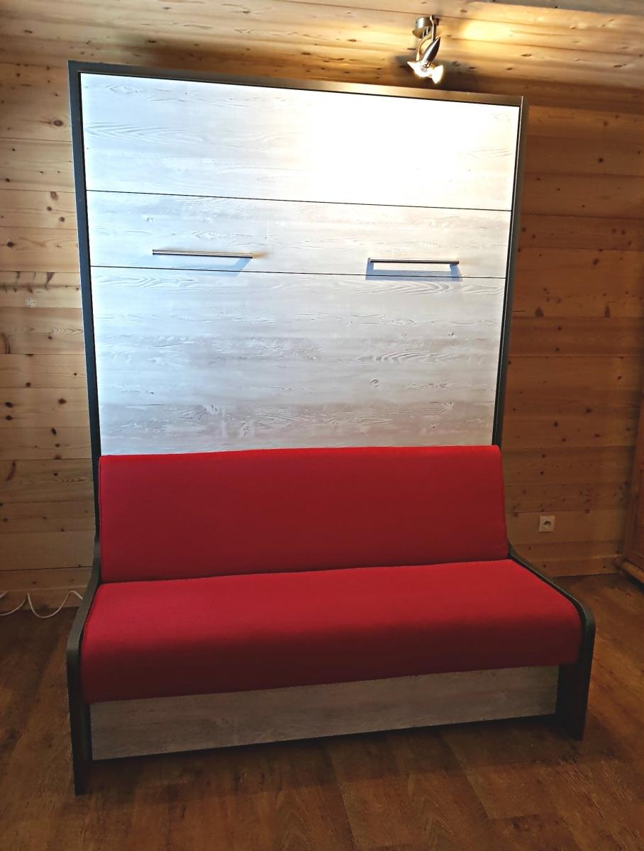 Lit escamotable canapé Premium XL installé en station